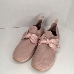 Mark Nason sneakers with a satin bow.